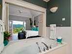 Upstairs,  the chic bedroom carries through the smart gray and white palate.  Shutters can close ... or be open from...