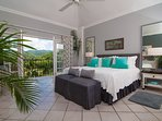 From the kingsize bed, French doors open to the iconic view of manicured golf course, blue-green mountains and the...