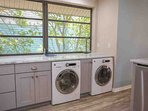 Full size washer and dryer in kitchen area