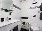 Bathroom inc washing machine (and powder) heated towel rail and heater for your comfort.