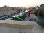 The stunning Three Cities bathed in evening light as seen from our rooftop  garden