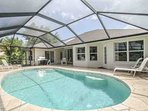View of spacious pool & deck. Conversational seating area added under lanai, table w/umbrella relocated. Updated pics...