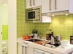 Kitchenette equipped with utensils and appliances for self-catering.