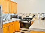 Fully equipped kitchen w/ full-size appliances, gas range, microwave, coffee maker, blender, toaster