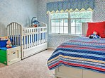 The 4th bedroom offers a twin-sized trundle bed, crib, and toddler bed.