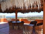 Rooftop palapa seating with views of Bay and City