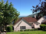 Exmoor Holidays has a large dog friendly secure private garden breathtaking sea views.  Patio &; BBQ