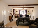 Exmoor Holidays spacious lounge-dining room fully equipped for 8 guests.  Wonderful sea views