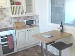 Fully equipped kitchen with sea and garden views