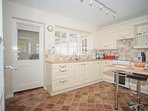 Fully equipped kitchen at Maxwelton.  Fridge/freezer, washing machine & tumble drier are in lobby