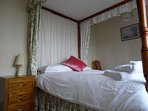 Exmoor Holidays Porlock Four poster double bedroom with sea views and ensuite w.c.