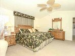 Well decorated master suite w/king bed and en suite bath is located directly off the dining area.