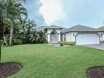 Meticulously manicured grounds lead to the entrance to your vacation oasis....3BR/2BA, 2 car garage (houses 2 bicycles...