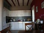 Kitchen with door to bbq area