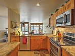 Whip up a mouth watering meal in the fully equipped kitchen with granite countertops.