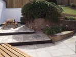 Exmoor Holidays private patio with seating for 8 and Barbecue