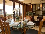 A dining room with ocean view is just one amenity in this Oahu vacation rental