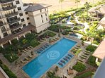 A view of the luxury resort pool from the lanai of this vacation rental by owner