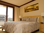 Master bedroom with luxury bed linens and ocean view
