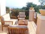 At the upstairs balcony you can enjoy the view of the Ionian sea while sipping on your drink.