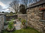 Privacy and quietness in sunny sheltered garden with slate patio for outside dining