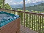 Soak in the hot tub as you take in the views.