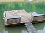 Dock with seating and a ladder to get out of the water after swimming. Storage hold swim gear.