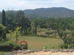 The view towards the Chateau de Lourmarin, nestling below the Grand Luberon