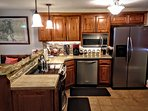 Beautiful functional kitchen with stainless steel appliances.