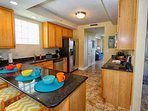 Stainless Steel Appliances and Black Granite Countertops
