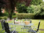 Large garden for guests to enjoy with garden furniture and barbeque available