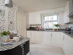 Bright kitchen with full range of modern appliances