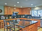 Grab a snack at the delightful island bar in the kitchen.