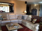 Living room sectional with 3 recliners