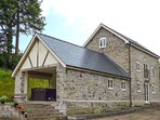 THE OLD MILL, luxury stone-built detached former mill, next to farm, with hot tu