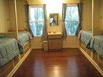 Teal Bunk room with 4 twin beds