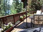 Everyone can enjoy lake and mountain views from the spacious redwood deck.