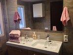 Bathroom 1. Double sink, walking shower, very spacious.