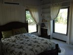 Bedrooms have beautiful views of the lush tropical garden