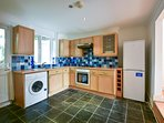 Electric oven and hob, fridge freezer, washing machine, microwave, toaster, crockery for 10, pans.