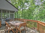The back deck is the perfect spot to unwind while enjoying your peaceful surroundings.