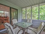 Enjoy a hot cup of coffee out on the screened porch.