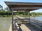 Covered seating on dock and fish cleaning table; looking back toward cottages