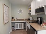 Kitchenette with stove, microwave, refrig and dishwasher