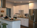 Open and inviting kitchen with everything you need for your stay