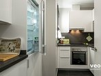 Modern kitchen equipped with all main utensils and appliances for self-catering.