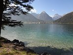 Clear water at the Achen Lake invite for swimming, kite surfing, sailing, fishing...