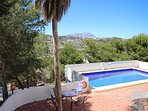 Extensive pool terrace. Plenty space for the sun loungers provided. Areas of shade.