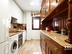 The kitchen includes a Nespresso coffee machine, oven, washing machine and dishwasher.