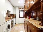 The kitchen includes a Nespresso coffee machine, oven, washing machine and dishwasher.